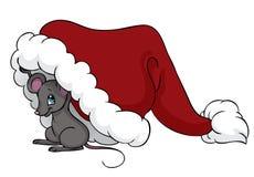 Little mouse under Christmas hat. A cute little mouse is peaking from below a Christmas hat Stock Photography