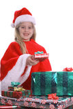 Little Mrs. Claus helping to pass out presents Stock Images