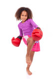 Little muay thai boxing girl using her knee. Isolated on white background stock photos
