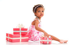Little mulatto girl with pink gift box. Birthday present. Shopping. Prize, win, event Stock Image
