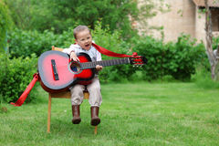 Little music student singing Royalty Free Stock Photo
