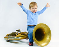Little musician. Little cute boy and tuba Stock Image
