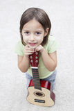 Little musician with guitar Stock Image