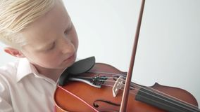 Little musician plays the violin. First year of studies at a music school at the violin course stock video