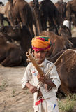Little musician of Pushkar. A little boy playing music in Pushkar fair, India Royalty Free Stock Photos