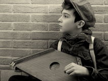 Little musician. Young musician playing his harp in a street stock images