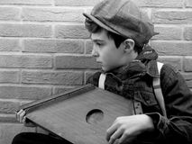 Little musician. Young musician playing his harp in a street royalty free stock photography