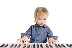 Little musicman. Little boy and the keyboard on white background Royalty Free Stock Images