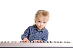 Little musicman. Little boy and the keyboard on white background Royalty Free Stock Photos