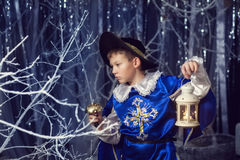 Little musketeer with flashlight Royalty Free Stock Image