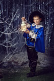 Little musketeer with flashlight Royalty Free Stock Photos