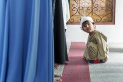Little muslim boy at the mosque royalty free stock photos