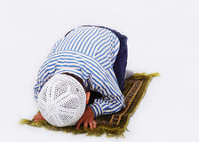 Little muslim boy is praying Stock Photos