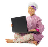 Little muslim girl with laptop Stock Photo
