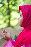 Little Muslim girl praying. Little Asian Muslim girl praying Royalty Free Stock Photography