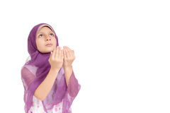 Little Muslim Girl praying. Ramadan Portrait - Little Muslim Girl making duaa (praying to Allah Stock Photos