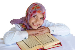 Little muslim  girl reads Koran Stock Images
