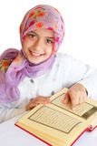 Little muslim girl reads Koran royalty free stock photos