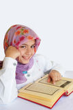 Little muslim  girl reads Koran Royalty Free Stock Image