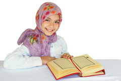 Little muslim girl reads Koran