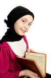 Little muslim girl reads Koran royalty free stock photography