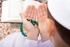 Little Muslim kid making duaa in Ramadan stock image