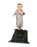 Little muslim kid is praying Stock Images