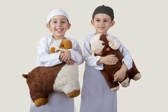 Free Little Muslim Kids Playing With Sheep Toys Royalty Free Stock Photo - 190919445