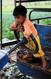 Little Myanmar child on a small truck Royalty Free Stock Image