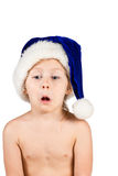 Little naked girl in a Christmas hat Royalty Free Stock Photography