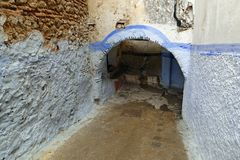 Little narrow alley with a passage in the colorful medina of Tétouan stock photos