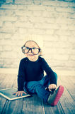 Little nerd. Cute baby with nerd glasses and white hat Royalty Free Stock Photography