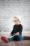 Little nerd. Cute baby with nerd glasses and white hat Stock Photo