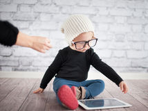 Little nerd. Cute baby with nerd glasses and white hat Stock Photography