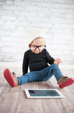 Little nerd. Cute baby with nerd glasses and white hat Royalty Free Stock Images