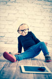 Little nerd. Cute baby with nerd glasses and white hat Stock Images