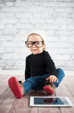 Little nerd. Cute baby with nerd glasses and white hat Royalty Free Stock Photo