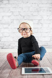 Little nerd. Cute baby with nerd glasses and white hat Royalty Free Stock Photos