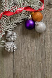 Little New year tree toys on the wood backing Stock Image