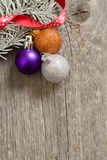 Little New year tree toys on the wood backing Royalty Free Stock Photo