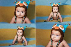 Little newborn baby with big eyes hat-knitting on a plain background. Royalty Free Stock Photos
