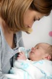 Little newborn baby boy in mothers arms Stock Image