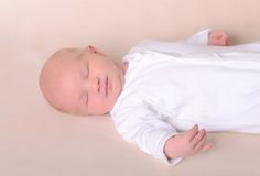 Little newborn baby boy sleeps Stock Images