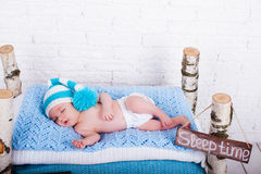 Little newborn baby boy sleeps. Wooden bed Royalty Free Stock Photo