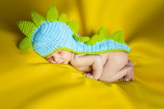 Little newborn baby boy on a yellow background stock images