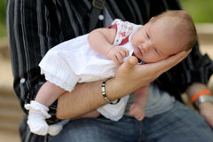 Little newborn baby in father's hands Stock Photography