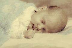 Little newborn baby girl 24 days sleeps Stock Photo