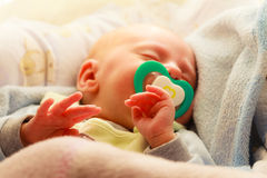 Little newborn baby girl 24 days sleeps Stock Photo