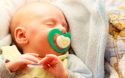 Little newborn baby girl 24 days sleeps Stock Image