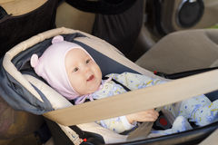 Little newborn baby girl rests in the car seat Royalty Free Stock Image